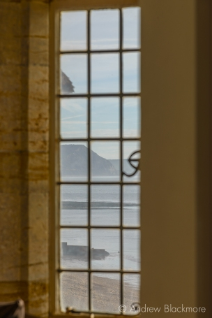 Golden Cap and the shoreline through a window in Sundial House, Lyme Regis 23_11_15 (1000px)