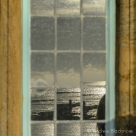 Sunlit sea reflected in a window of Sundial House, Lyme Regis 23_11_15-1 (1000px)