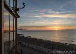 Sunrise over Lyme Bay through a window in Sundial House, Lyme Regis 23_11_15-1 (1000px)